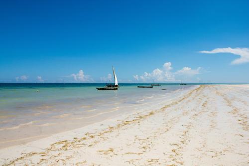 Wall mural Sunny Kenya, beach, boat, sun, sand, sailboat, shades of blue, blue sky