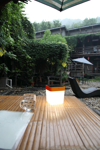 Outdoor solar table lamp Lutec TABLE CUBE orange