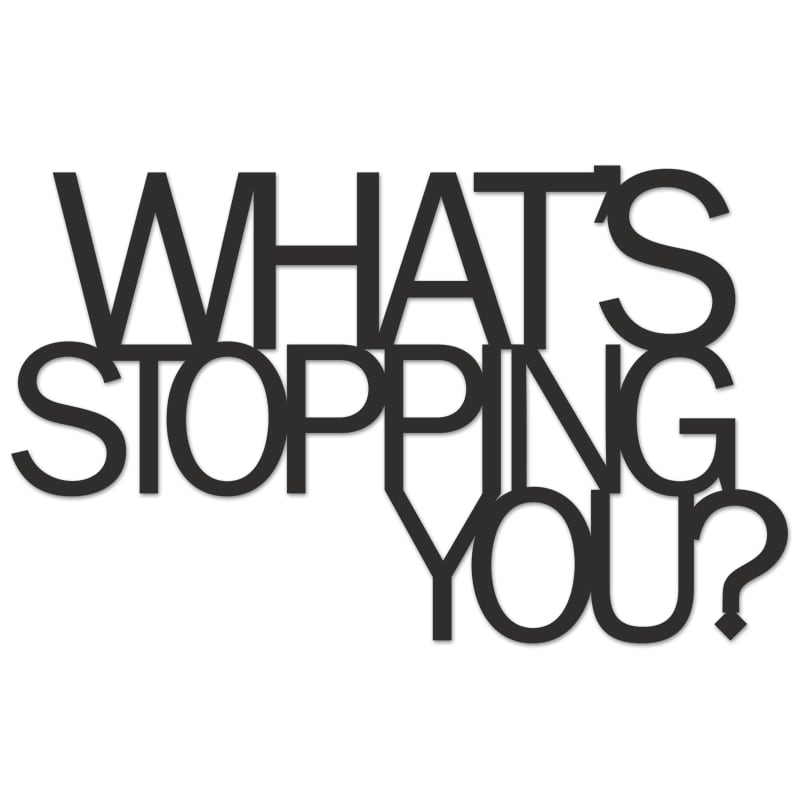 Inscription on the wall WHATS STOPPING YOU?