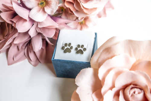 Silver earrings with a dog's paw motif