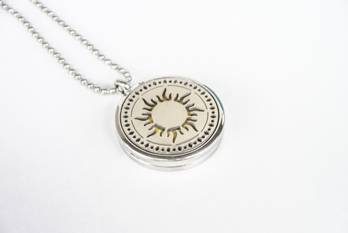 Scented pendant with an oil diffuser - with a sun motif