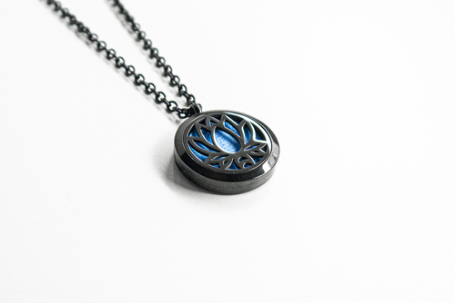 Black scented pendant with an oil diffuser - with a lotus flower motif