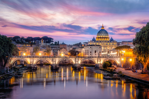 Wall mural Rome at sunset, the illuminated Vatican and the Basilica of Saint. Peter